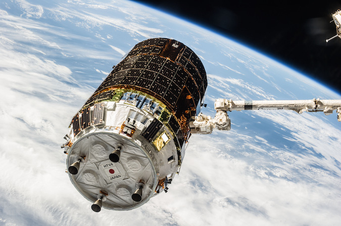 Japan's fourth HTV supply ship in the grasp of the space station's robotic arm in 2013. Credit: JAXA