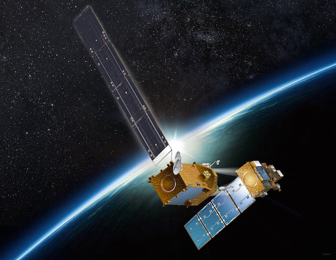Artist's concept of the Restore-L spacecraft (left) with the Landsat 7 satellite (right) for an in-orbit refueling demonstration. Credit: Space Systems/Loral