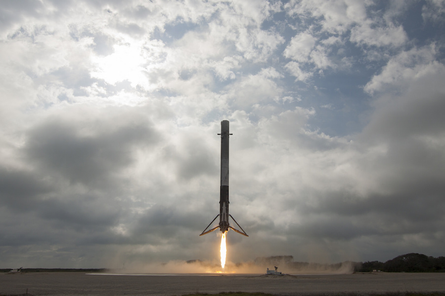 a falcon 9 rocket s first stage booster lands at cape canaveral air force station on feb 19 following a launch from nearby kennedy space center with a