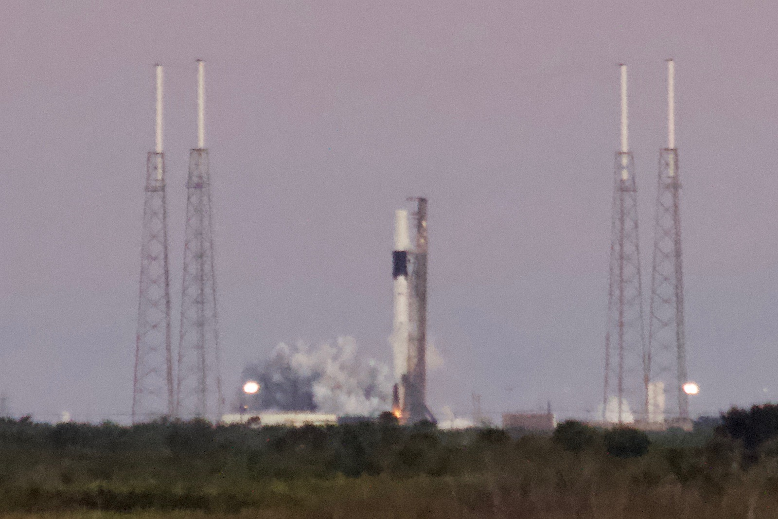 SpaceX test-fires Falcon 9 rocket for next space station cargo launch