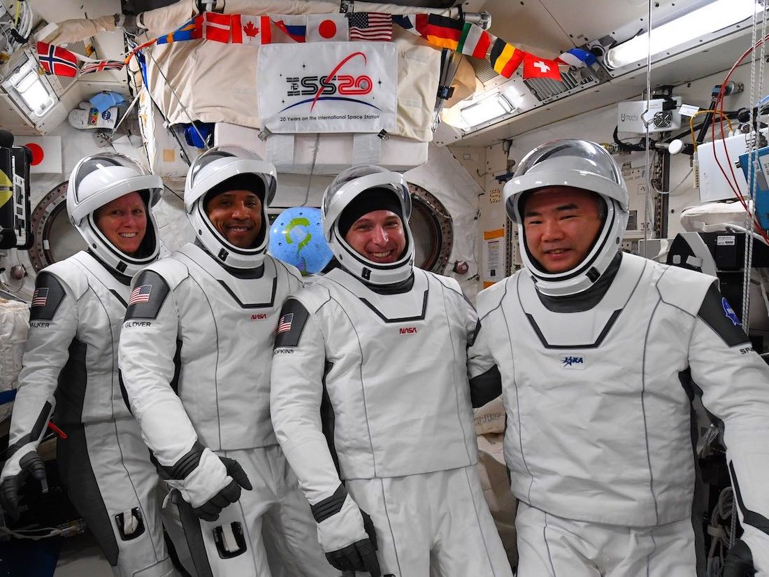 - crew1 suits - SpaceX's Crew Dragon capsule swaps docking ports on space station – Spaceflight Now