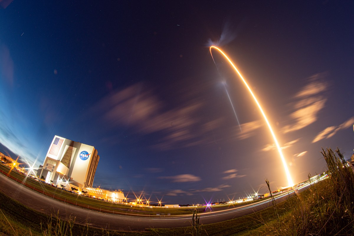 Four private citizens ride SpaceX rocket into orbit on historic mission